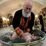 6 week old baby dies who got water in his lungs at the baptism ceremony