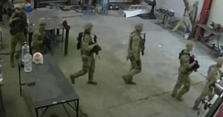 The workers at the factory were shocked to see the NATO soldier in front of them Investigation launched
